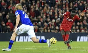 Liverpool's Sadio Mane scores their fourth goal against Everton.