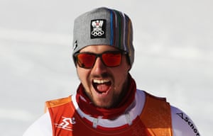 Marcel Hirscher of Austria celebrates winning gold at the finish during the men's alpine combined slalom.