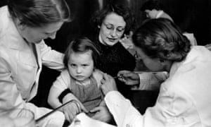 A girl is given a vaccine against poliomyelitis.