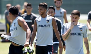 Giovani Dos Santos leaves the field after training at the StubHub Center.