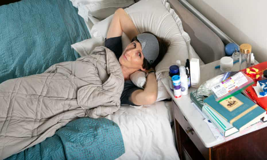 Emma Beddington, in bed, awake.