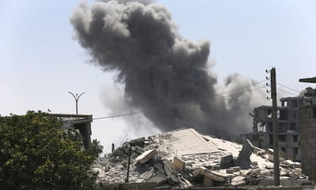 Smoke rises from a coalition airstrike on the eastern side of Raqqa on 26 July, when 62 civilians were reportedly killed by such attacks.