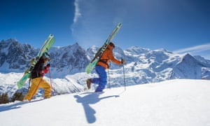 Two skiers walking in the snow in Chamonix, France