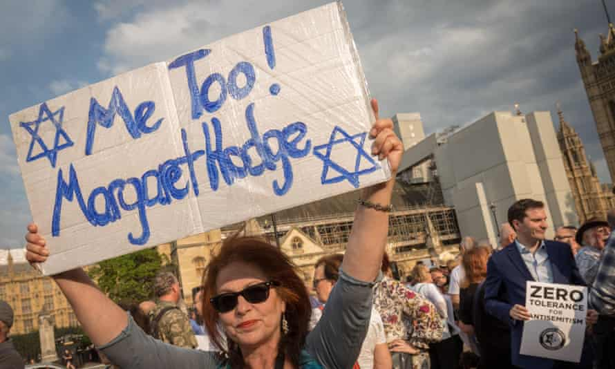 A woman takes part in an antisemitism demonstration in Parliament Square