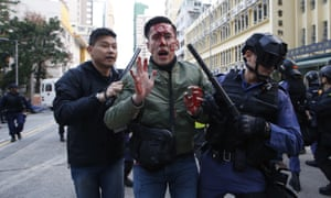 A rioter is taken away by police on a street in the Mongkok district of Hong Kong