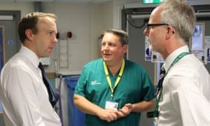 The health secretary, Matt Hancock, chats to Stephen Dunn, chief executive of West Suffolk NHS foundation trust and the hospital's medical director Nick Jenkins