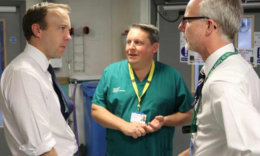 The former health secretary Matt Hancock chats to Stephen Dunn, the departing chief executive of West Suffolk NHS foundation trust, and the hospital's former medical director Nick Jenkins.