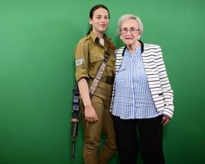 Holocaust survivor Marion Bazmen with an Israeli soldier.