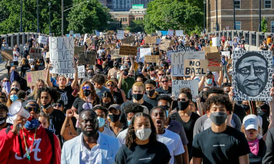 Thousands of protesters march on Friday from downtown to the site of the arrest of George Floyd in Minneapolis.