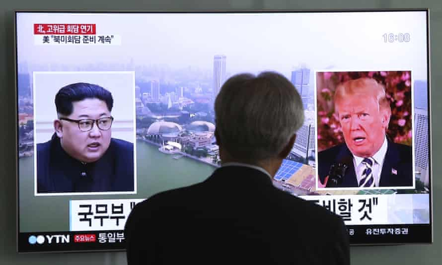 A man watches a TV screen showing file footage of US president Donald Trump, right, and North Korean leader Kim Jong Un at the Seoul railway station in South Korea on Wednesday.