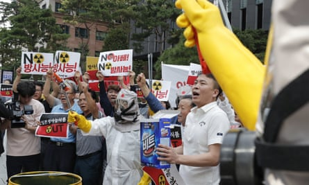 South Korean business owners and workers call for a boycott of Japanese products during a protest near the Japanese embassy in Seoul.