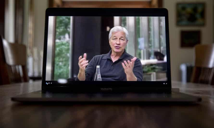 Jamie Dimon, speaks during a webcast event on a laptop computer in Tiskilwa, Illinois, US.