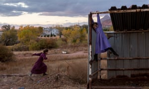 FLDS girls, Lydia Richter, 8, and Kathy Bistline, 8, play in a makeshift stable in Colorado City, Arizona