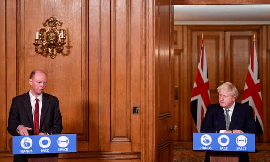 The chief medical officer, Chris Whitty, with Boris Johnson as the PM announces his three-tier plan on Monday.