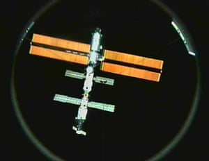INTERNATIONAL SPACE STATIONThe International Space Station's solar arrays are aglow against the darkness of space after undocking from Discovery Sunday, March 18, 2001. This view is from the Discovery's docking port television camera. (AP Photo/NASA TV)