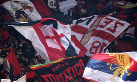 Genoa supporters wave flags during an Italian Serie A football match against Juventus.