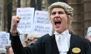A barrister demonstrates in support of legal aid