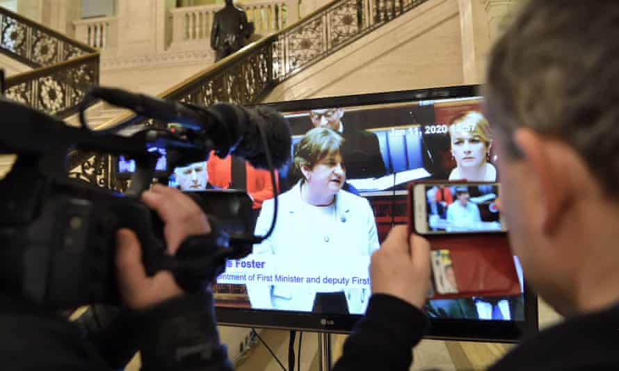 Journalists watch a live feed of proceedings at Stormont on Saturday