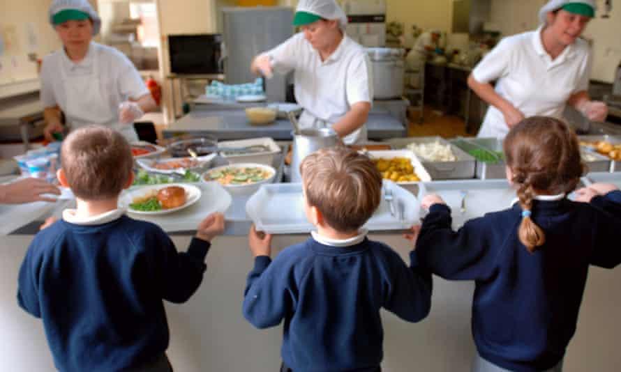 Schoolchildren being served lunch
