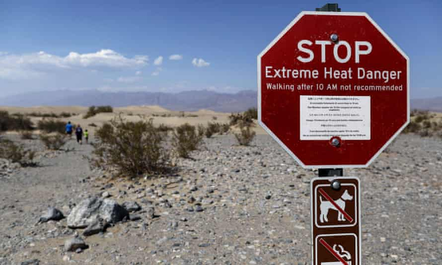 A sign in Death Valley national park warns visitors of extreme heat danger.