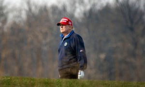 Donald Trump playing golf on Sunday at Trump National Golf Club in Sterling, Virginia.