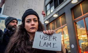 Dozens protested outside Uber's headquarters in Long Island City, the day before Uber CEO, Travis Kalanick, was to meet with Donald Trump as part of his advisory council on 2 February in New York City.
