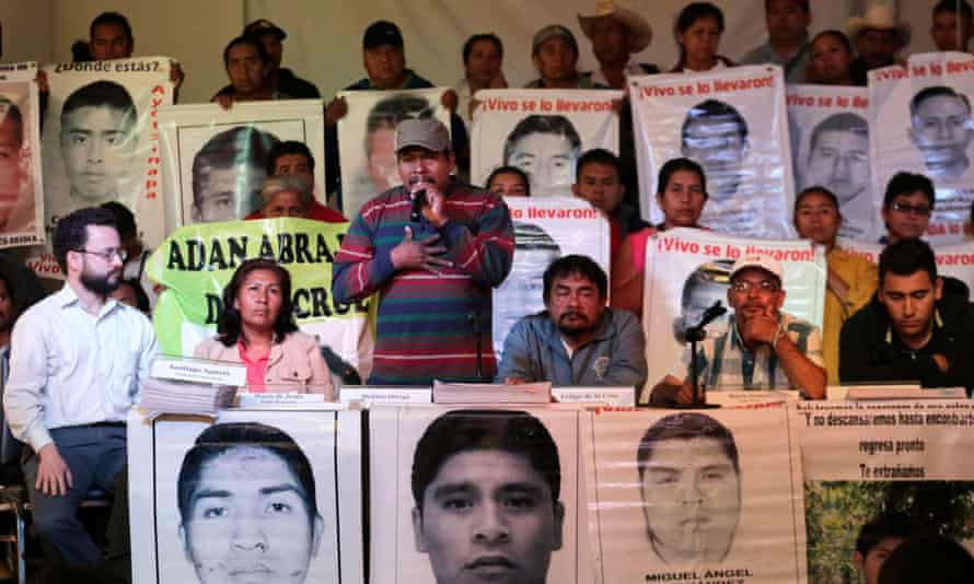 Melitón Ortega (centre), the uncle of a student from Ayotzinapa teacher training college, with other relatives of the missing.