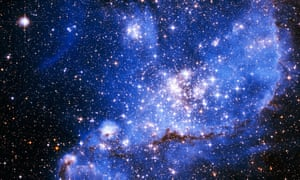A bight blue cloud of dust and gas in deep space