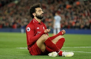 "Mo Salah prays after he scores the fifth Liverpool goal and his second to beat Huddersfield 5-0 at Anfield and move to the top of the table ahead of Manchester City's game against Burnley. Liverpool have now amassed more points than Arsenal's unbeaten ""Invincibles"" team of 2003-04 and have 12 points more than the Manchester United Treble-winning team of 1998-99. No team has ever reached this number of points (91) and not gone on to win the title."