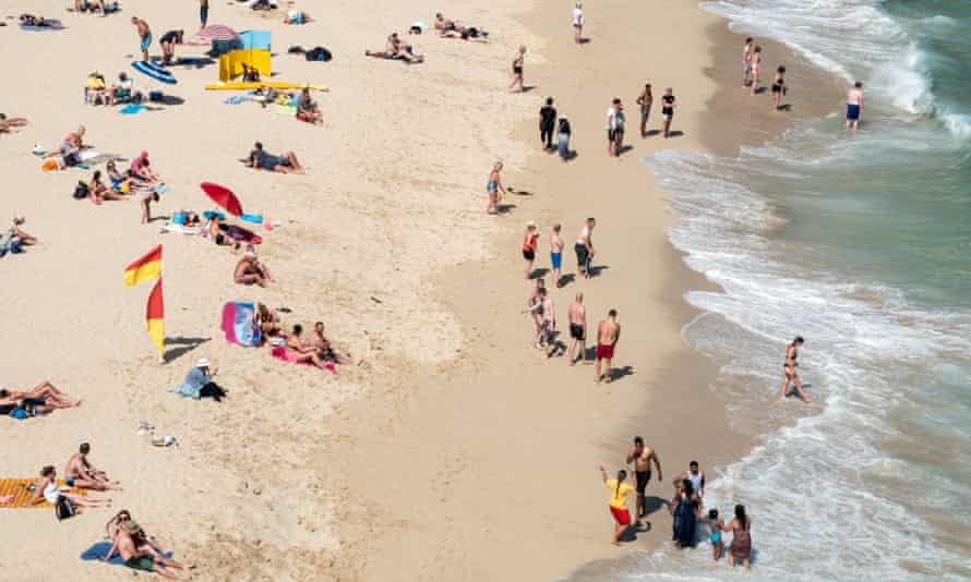 People enjoy the sunshine on Porthcurno beach, Cornwall, last month.