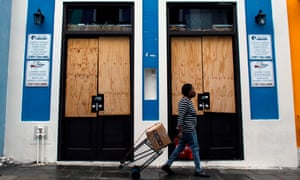 A boarded-up business in San Juan, the capital. Maria pummelled Puerto Rico with winds of up to 154mph, and damaging or wiping out 230,000 homes.