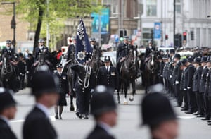 Police officers line the route in Southwark