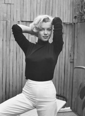 Actress Marylin Monroe Playfully Elegant at Home (1953) photographed by Alfred Eisenstaedt.