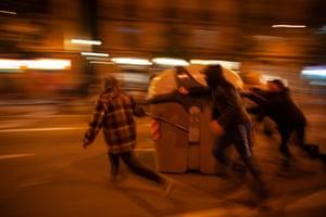 Protesters block the passage of police vans in Barcelona last week