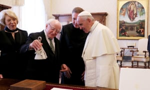 Michael D Higgins and wife Sabina Coyne presents the pope with a 'climate bell'.