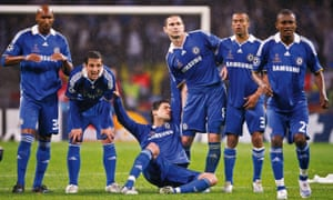 Chelsea players watch a pivotal moment in the 2008 Champions League final.