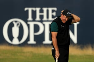 Phil Mickelson reacts after his birdie putt narrowly missed on the 18th.