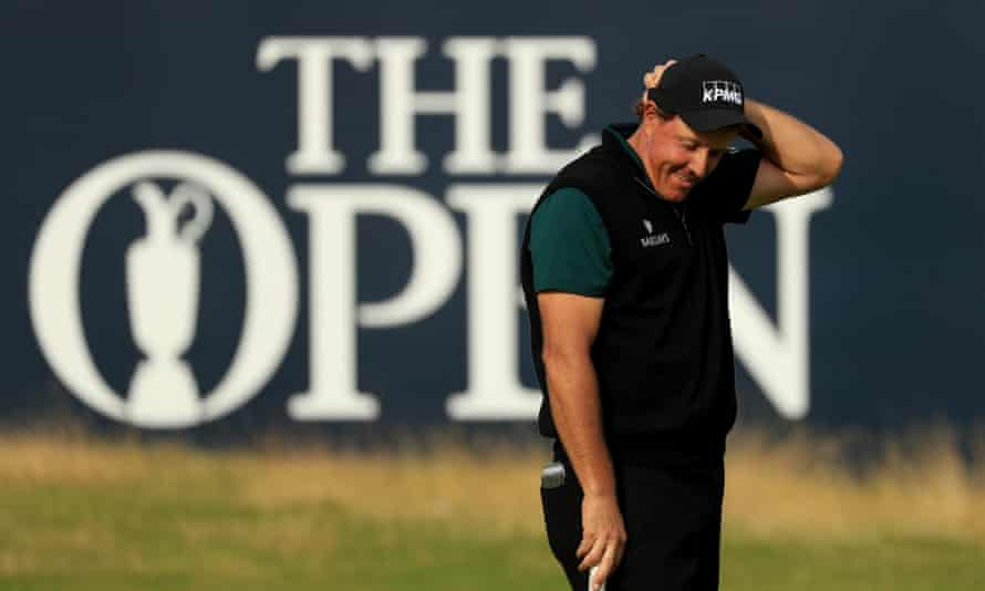 Phil Mickelson offers a rueful smile after watching his attempt to become the first player to shoot under 63 at a major championship fail by an impossibly small margin.