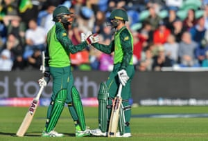 Quinton de Kock celebrates with Hashim Amla after scoring fifty.