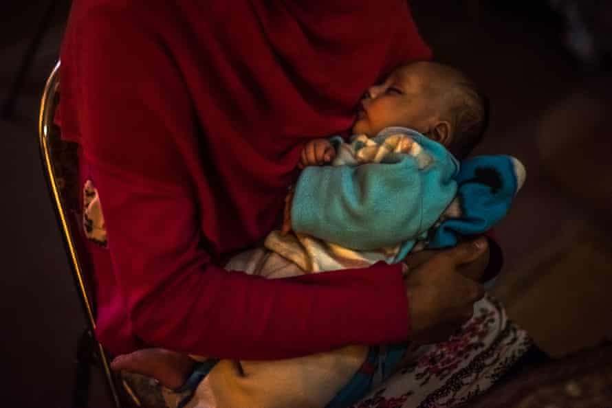 A 17-year-old holds her month-old son at a women's shelter in Kabul in 2017
