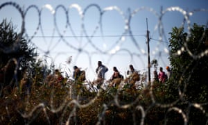 Migrants arrive at the border line between Serbia and Hungary near Roszke, southern Hungary, Sept. 13, 2015.