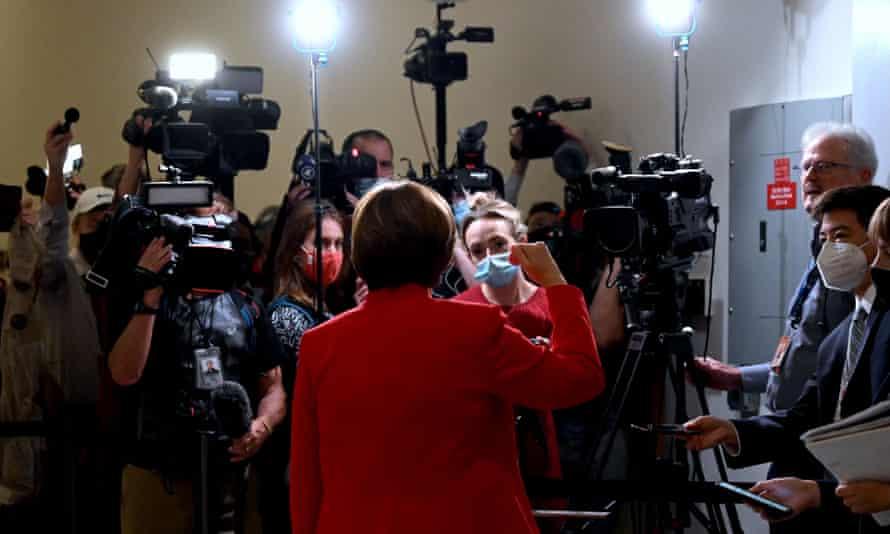 Senator Amy Klobuchar talks with the media as she arrives for Tuesday's hearing.