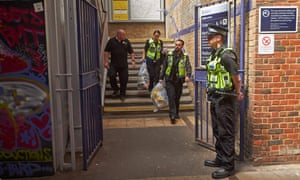 British Transport Police officers carry evidence bags as they leave from Brixton train station after investigating the deaths at Loughborough Junction.