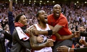 Kawhi Leonard celebrates his last-second basket with teammates