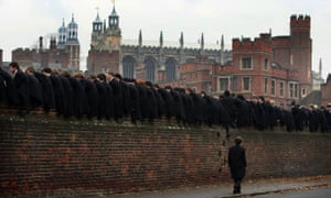 Students at Eton College watching the 'Collegers' and the 'Oppidans' teams playing the 'Eton Wall Game'