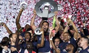 Radamel Falcao holds aloft the Ligue 1 trophy after Monaco's 2-0 win over St-Étienne secured the title.