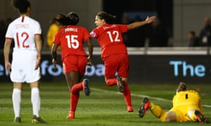 Canada's Christine Sinclair celebrates the opening goal.