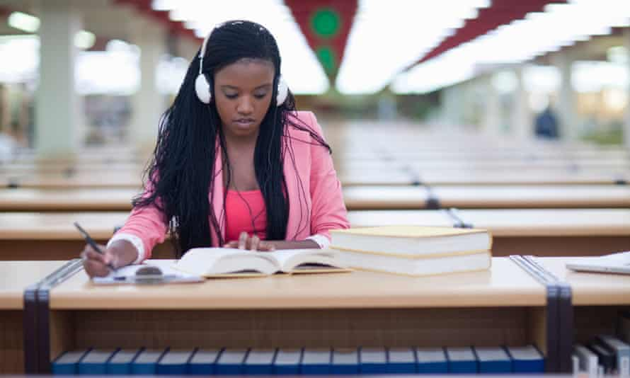 Female student studying in library.