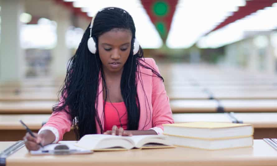 A girl studying while listening to music