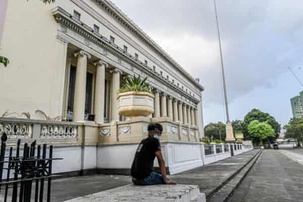 A man sitting in the Liwasang Bonifacio plaza in central Manila